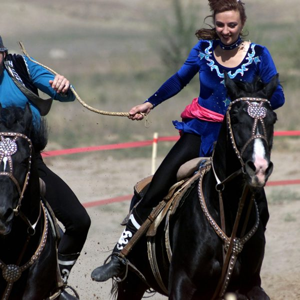 As part of the Gala concert of CENTRASBAT 00, Kazakh performers demonstrate a cultural tradition of a game called catch a girl, in which the two riders (male and female) take off on horseback and try and catch each other. The female rider whips the male until she is caught. If the male catches the female he is then rewarded with a kiss. The Gala concert was a show put on by Kazakhstanis, showing a variety of traditional dances and cultural events. CENTRASBAT is a multi-national peacekeeping and humanitarian relief exercise sponsored by US Central Command (US CENTCOM) and hosted by former Soviet Republic Kazakhstan in Central Asia, from Sept. 11-20. CENTRASBAT will test US and Central Asian units combat readiness and ability to conduct peacekeeping and humanitarian operations, as well as develop and build cooperative relationships between the respective states and assist in laying the foundation for future peacekeeping and humanitarian operations.
